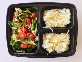 Packed lunch: spinach salad with egg, tomatoes, and goat cheese, with mashed potatoes